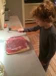Pouding out the flank steak