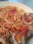 sliced braciole with spaghetti and sauce